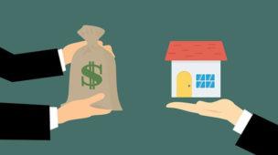 desenho de um saco de dinheiro e de uma casa os quais simbolizam a compra de um imóvel